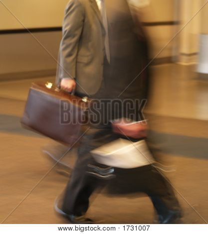Businessmen Walking In A Hurry