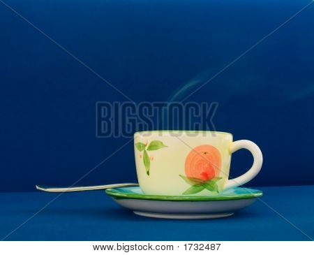 Steaming Coffee Cup On Blue