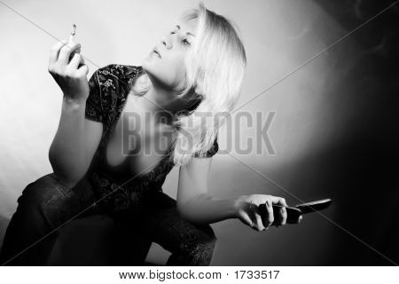 Beautiful Woman With Cigarette And Phone