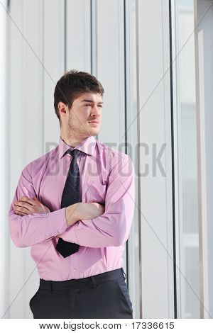 young business man lawyer with laptop alone in big bright   conference room