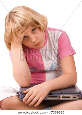 Difficult sum. Ten years old girl with laptop