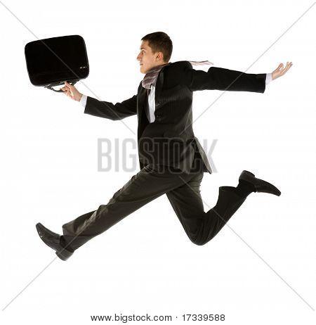 junger Geschäftsmann mit Aktenkoffer ausgeführt für Erfolg