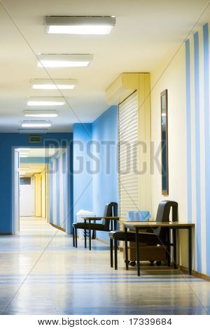 reception in hospital with corridor at evening time