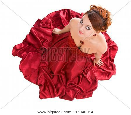young attractive woman sitting in long red dress. view from above/