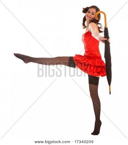 mulher sorridente Youn, saltando com guarda-chuva