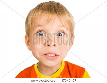 very surprised five-year-old boy isolated on white background