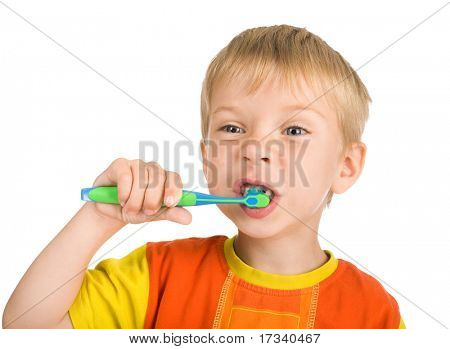 smiley boy without one teeth cleans a teeth isolated on white background