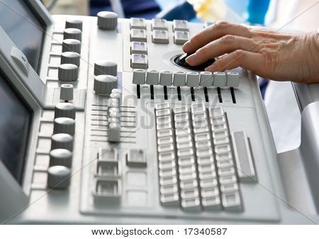 Ultrasound medical device keyboard with doctor's hand. Image with shallow DOF.