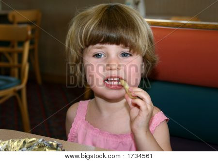 Little Girl Eating French Fry