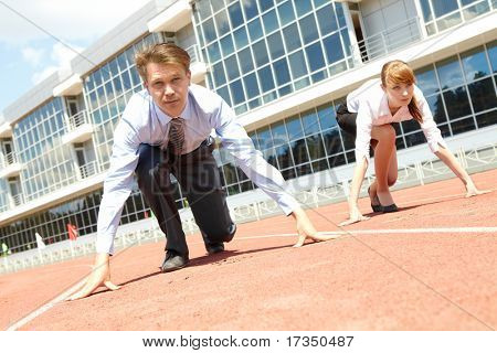 Confident business people getting ready for race