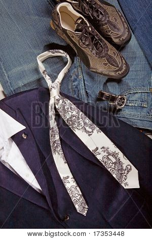 Tie a composition from clothes and accessories