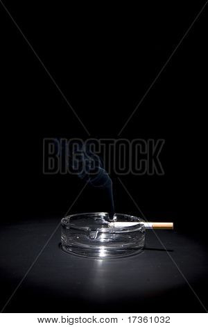 smoke and cigarettes in ash-tray