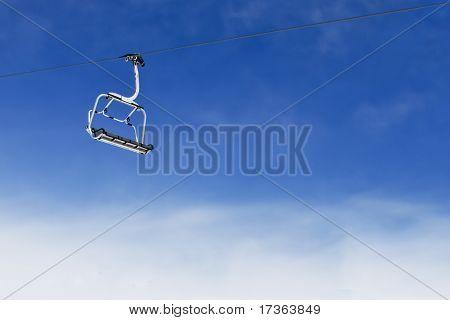 Ski Lift Chair On Bright Blue Sky
