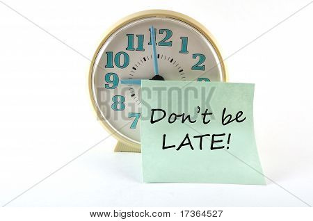 Clock With Sticker Don`t Be Late. General Concept