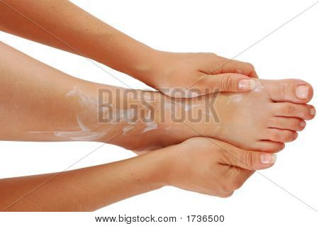 Young Woman Cover Her Leg With Skin Creme
