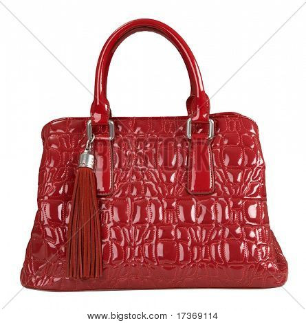 red patent handbag with a brush