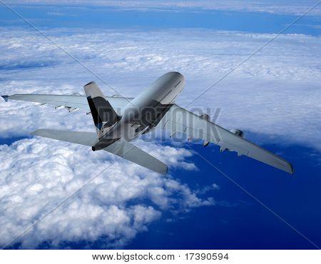 Das Jet-Flugzeug auf einem Hintergrund des Himmels