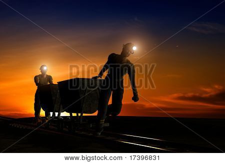 Silhouettes of workers in the night sky.