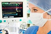 foto of icu  - Female doctor in intensive care unit with surveillance monitor - JPG