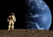 image of spaceman  - the astronaut on a background of a planet - JPG