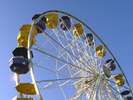 stock photo of ferris-wheel  - interesting perspective shot of a ferris wheel against a clear blue sky - JPG