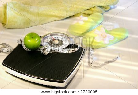 Weight Scale On Tile Floor With Towel And Slippers