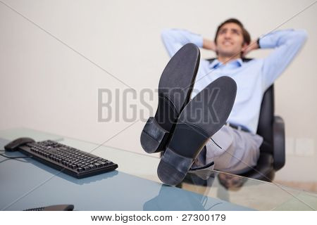 Young businessman leaning back taking a moment off