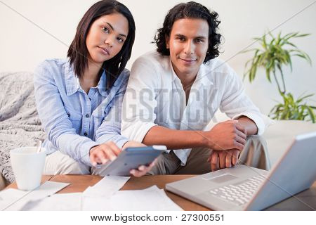 Young couple paying their bills online