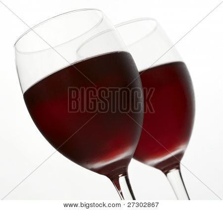 Two glasses of red wine on a white background