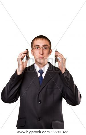 Business Man Talking On A Two Mobile Telephone