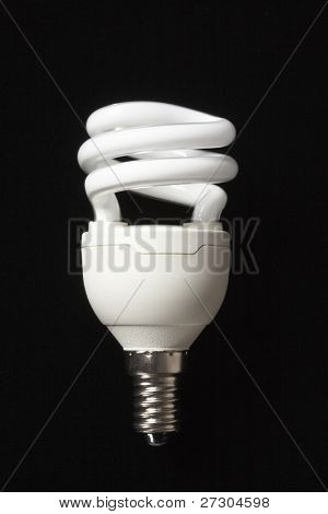Energy saver Light bulb isolated on black