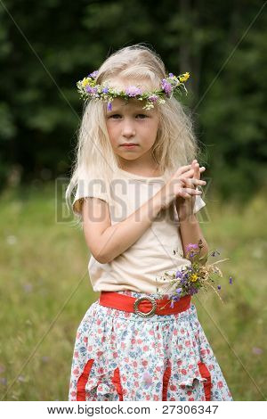 Little Girl Standing At The Meadow