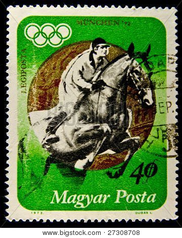 HUNGARY - CIRCA 1973: A stamp printed in Hungary showing jockey riding horse, circa 1973