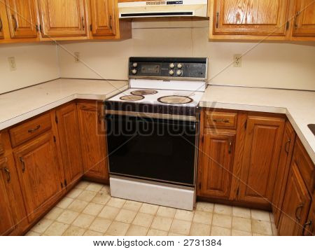 Stove And Cabinets In An Old Kitchen