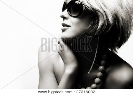Fashion woman portrait wearing sunglasses on white background
