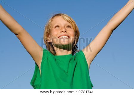 Happy Smiling Child Arms Raised With Joy