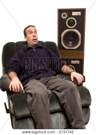 Caucasian Man Listening To Music