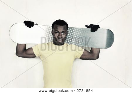 Teenager Holding A Snowboard