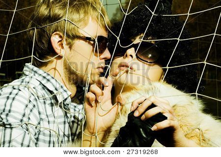 Fashionable young couple wearing sunglasses. Art photo