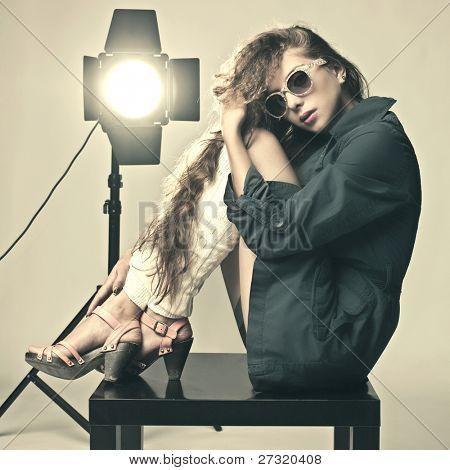 Fashion art portrait of a beautiful young sexy woman wearing sunglasses