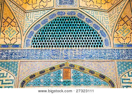 Tiled oriental ornaments Ateegh Jame mosque's wall , Esfahan, Iran