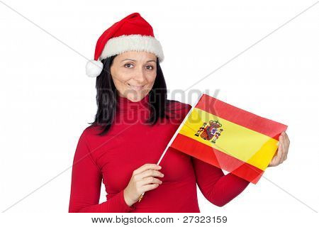 Beautiful girl with Christmas hat and spanish flag on a over white background