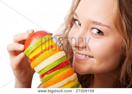 Portrait of happy young woman holding  mixed fruits over white background