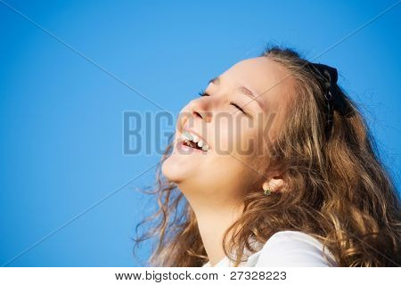 beautiful  girl on a blue sky background