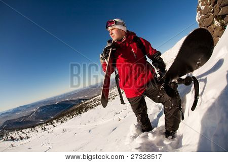 skier on a top over blue sky