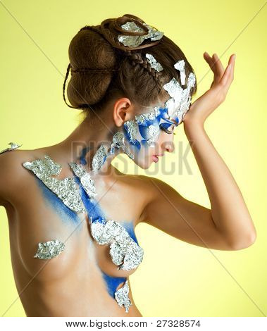 portrait of beautiful girl with creative bodyart