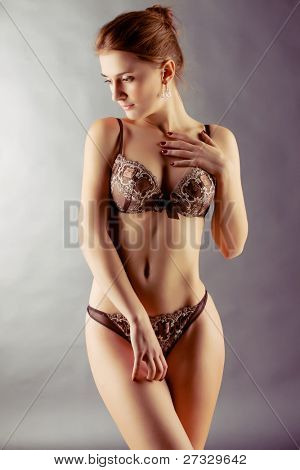 Sexy blonde in lingerie over blue background