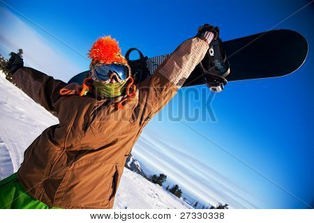 portrait of a young man with the snowboard