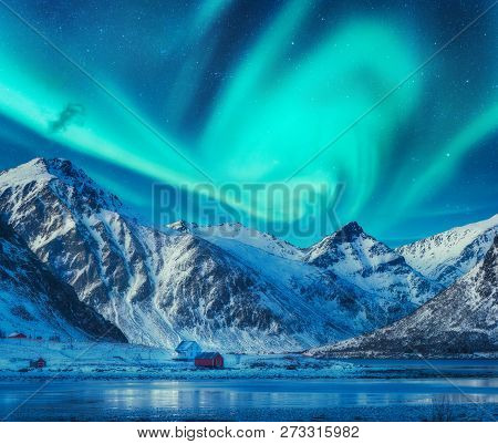 Northern Lights Above Snowy Mountains