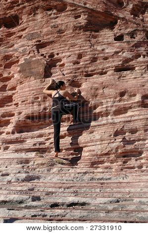 A girl climbing a rock wall in Red Rock Canyon, Nevada